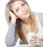 young woman holding a glass of fresh milk Royalty Free Stock Photo
