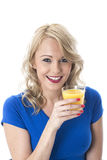 Young Woman Holding Glass of Fresh Orange Juice Royalty Free Stock Photography