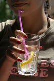 Young woman holding a glass of lemonade Royalty Free Stock Images
