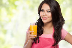 Young woman holding glass of orange juice Royalty Free Stock Photography
