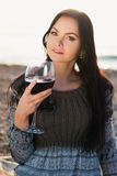 Young woman holding glass of red italian wine Royalty Free Stock Image