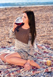 Young woman holding glass of red italian wine. sunset Royalty Free Stock Image