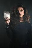 Young woman holding a glass of smoke Royalty Free Stock Photos