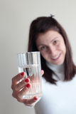 Young woman holding glass of water Stock Photo