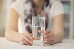 Young woman holding glass of water Stock Photography