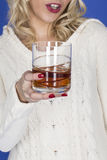 Young Woman Holding a Glass of Whiskey Stock Photos