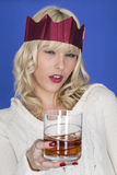 Young Woman Holding a Glass of Whiskey Royalty Free Stock Photos