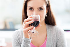 Woman having glass of wine Royalty Free Stock Photography