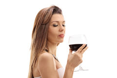 Young woman holding a glass of wine Royalty Free Stock Photo