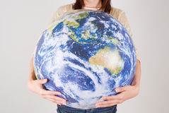 Young woman holding globe. Midsection of young woman holding globe Stock Photos