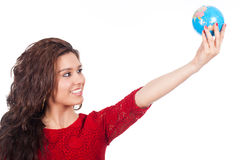 Young woman holding a globe in hand Royalty Free Stock Photo
