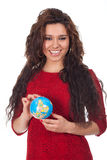Young woman holding a globe in hands Stock Photography