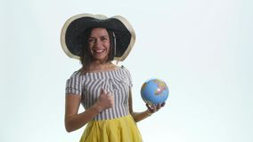 Young woman holding a globe in his hands stock images