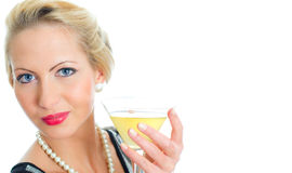 Young woman holding goblet with cocktail. Royalty Free Stock Photo