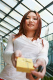 Young woman holding a golden gift box Stock Images