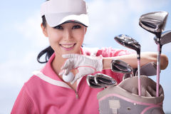 Young woman holding golf clubs Royalty Free Stock Photography