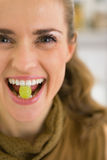 Young woman holding grape in mouth Royalty Free Stock Images