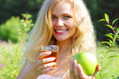 Young woman holding green apple Stock Images