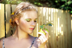 Young woman holding a green apple Royalty Free Stock Photo