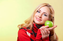 Young woman holding green apple Royalty Free Stock Photography