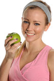 Young Woman holding a green apple Royalty Free Stock Image
