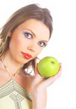 Young woman holding a green apples Royalty Free Stock Photos