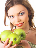 Young woman holding a green apples Stock Photo