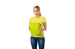Young woman holding green bucket. Royalty Free Stock Images