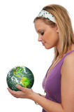 Young woman holding the green earth Royalty Free Stock Photography