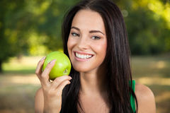 Young woman holding green fresh apple Stock Images