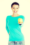 Young woman holding green fresh apple Royalty Free Stock Images
