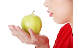 Young woman holding green fresh apple Royalty Free Stock Image