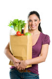 Young woman holding a grocery bag stock photos