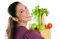 Young woman holding a grocery bag close up Royalty Free Stock Images