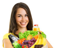 Young woman holding a grocery bag Stock Images