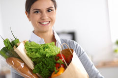 Young woman holding grocery shopping bag with Stock Photography