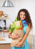 Young woman holding grocery shopping bag with Stock Images
