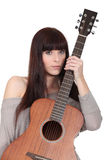 Young woman holding a guitar Stock Photography