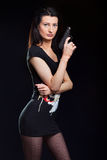 Young Woman Holding Gun Royalty Free Stock Photos