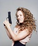 Young woman holding a gun Stock Photo
