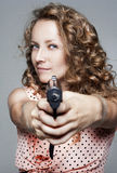 Young woman holding a gun Royalty Free Stock Photography