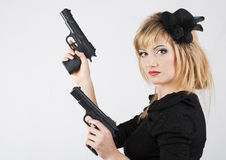 Young woman holding a gun. On white background royalty free stock image