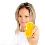 Young woman holding half an orange Royalty Free Stock Photo