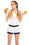 Young woman holding a hamburger and an apple Royalty Free Stock Image