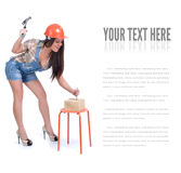 Young woman holding hammer and nail Royalty Free Stock Photography