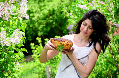 Young woman holding hand made easter bread outdoor Royalty Free Stock Photography