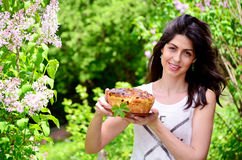 Young woman holding hand made easter bread outdoor Royalty Free Stock Photo