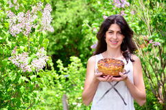 Young woman holding hand made easter bread outdoor Royalty Free Stock Image
