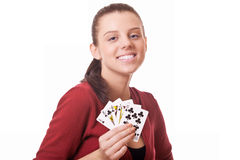 Young woman holding in hand poker card Royalty Free Stock Image