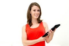 Young woman holding in hand a tablet touch pad Stock Photos